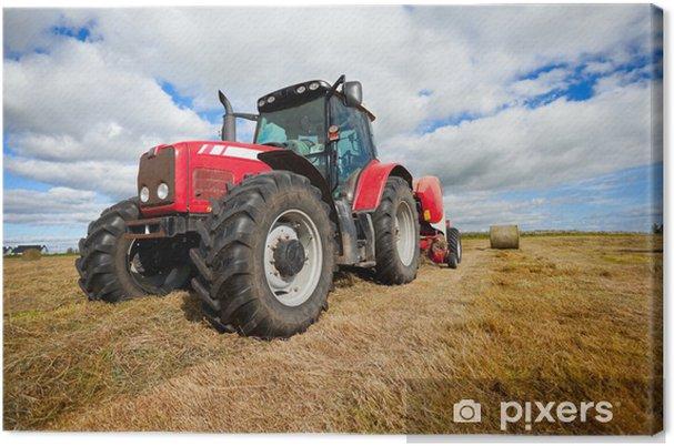 Cuadro en Lienzo Tractor recogida pajar en el campo - Temas