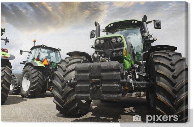 Cuadro en Lienzo Tractores gigantes contra un cielo puesta del sol y las nubes - Temas