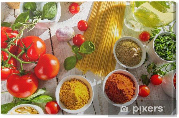 Cuadro en Lienzo Verduras frescas y especias en la cocina italiana - Temas