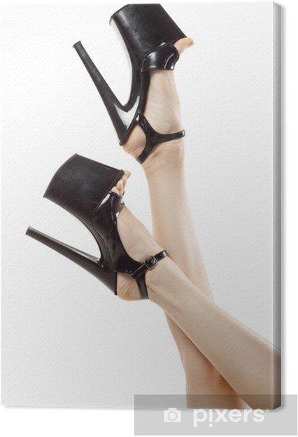 8d6762c7460 Kvindelige ben iført sorte høje hæle isoleret på hvidt backgroun Fotolærred  -