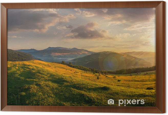 agricultural field in mountains at sunset Framed Canvas - Panorama