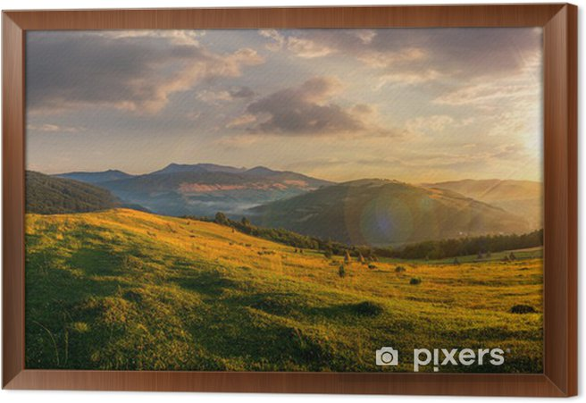 agricultural field in mountains at sunset Framed Canvas - Themes