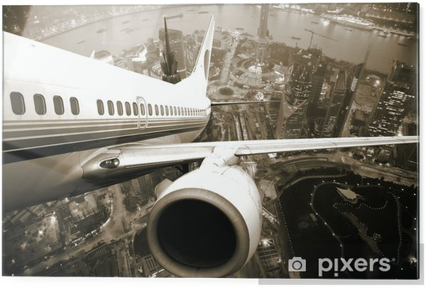 Glass print Airplane take off from the city -