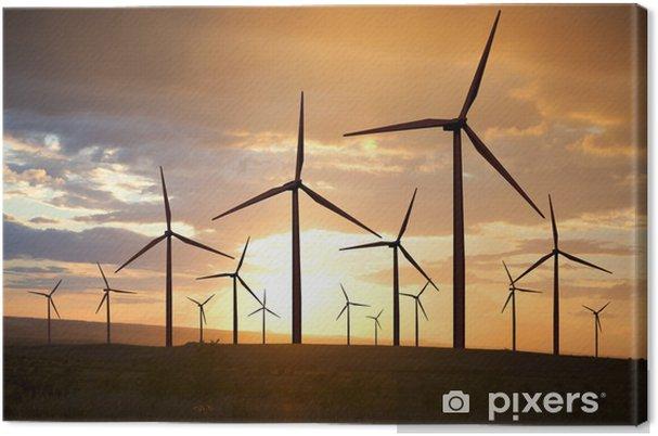 Tuulivoimaloita auringonlaskun taivaalla Kangaskuva - Mills and windmills