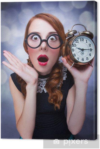 Yllättynyt punapää tyttö kellolla. Kangaskuva - Themes