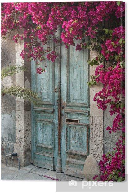 Leinwandbild Alte hölzerne Tür mit Bougainvillea in Zypern - iStaging