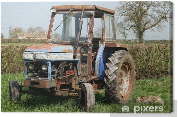 Leinwandbild Alte rostige Traktor im Feld - Landwirtschaft