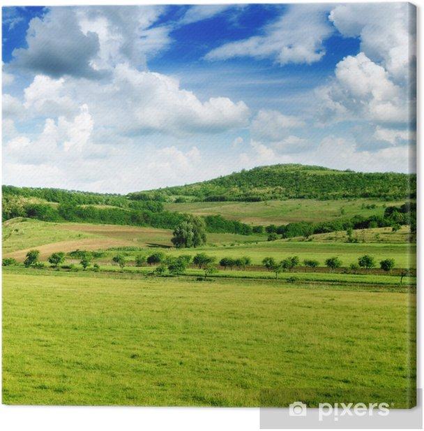 Leinwandbild Bergiges Gelände und den blauen Himmel - Himmel
