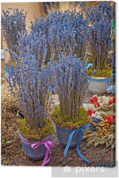 Leinwandbild Bunch of lavender flowers on a wood table - Blumen