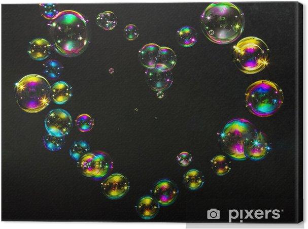 Leinwandbild Bunten Blasen in der Form von Herzen auf einem dunklen Hintergrund - Zeichen und Symbole