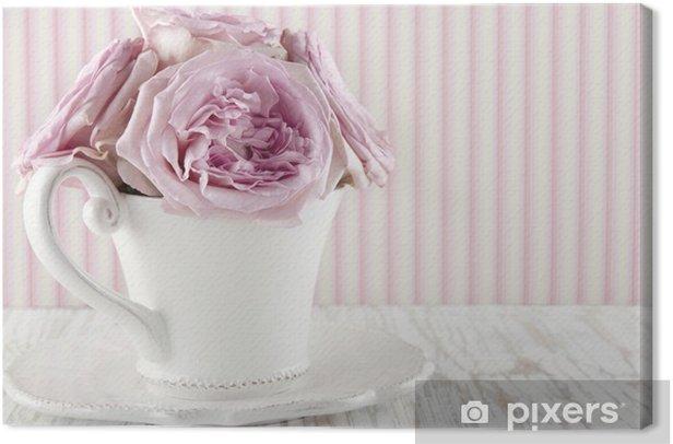 Leinwandbild Cup mit einem Strauß rosa Rosen gefüllt - Blumen
