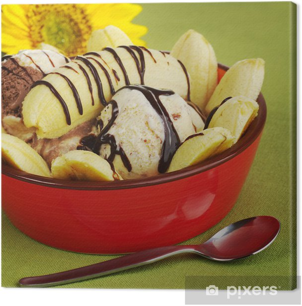 Leinwandbild Dessert: Banana Split in der Schüssel mit Sonnenblume (Selective Focus) - Süßwaren und Desserts