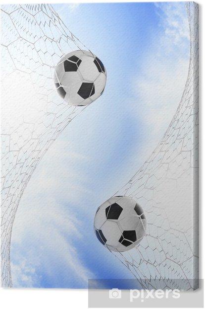 Leinwandbild Fußballfußball im Tornetz mit blauem Himmel - Freiluftsport