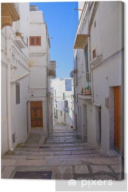 Leinwandbild Gasse. Castellaneta. Puglia. Italien. - Themen