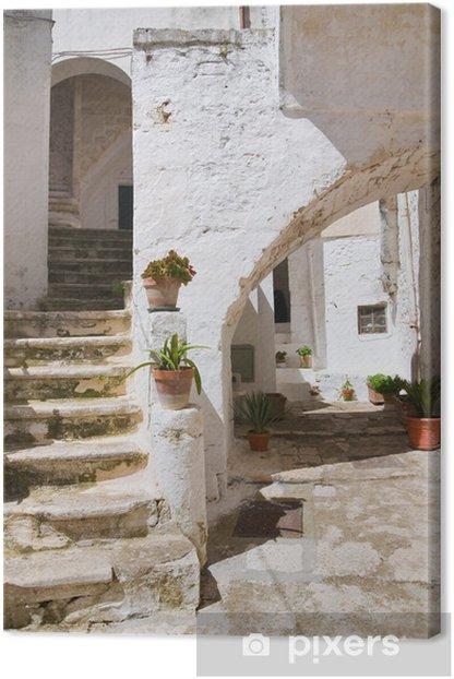 Leinwandbild Gasse. Ceglie. Puglia. Italien. - Urlaub