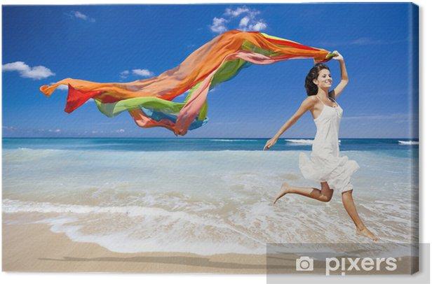 Leinwandbild Glückliche Frau Springen am Strand - Themen