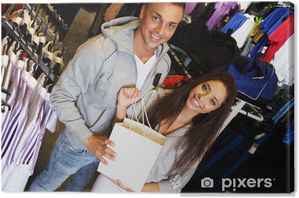Leinwandbild Glückliche junge Paar mit Einkaufstasche in Sportswear Store - Fashion