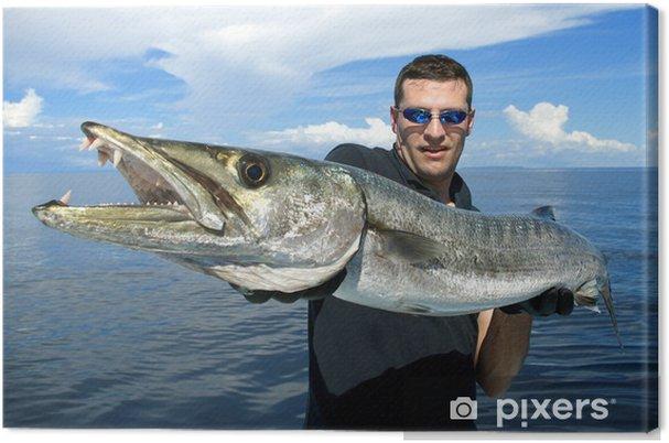 Leinwandbild Glücklicher Fischer, die eine riesige Barrakudas - Freiluftsport