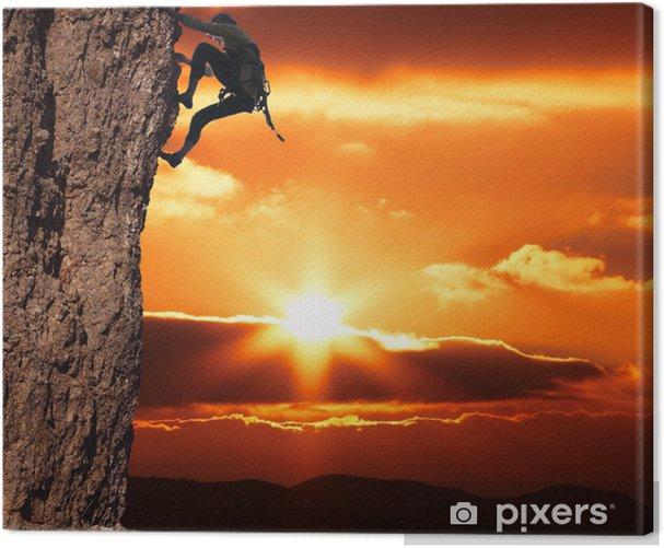 Leinwandbild Kletterer auf sanset - Themen
