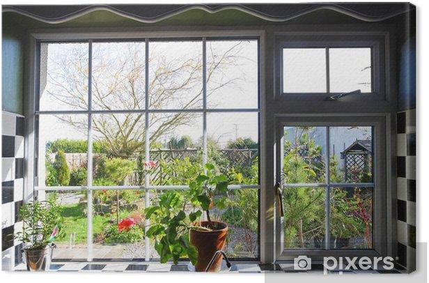 Leinwandbild Küchenfenster mit Blick auf Garten - Bereich