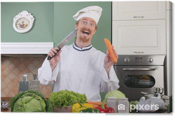 Leinwandbild Lustige junge Küchenchef bereitet Mittagessen in der Küche
