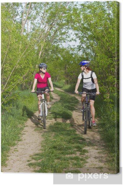 Leinwandbild Mädchen Radfahren im Wald - Radsport