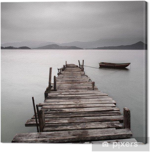 Leinwandbild Mit Blick auf einen Pier und ein Boot, niedriger Sättigung -
