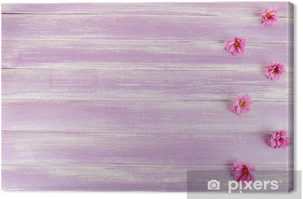Leinwandbild Schöne Chrysantheme Blumen auf lila Holzuntergrund - Blumen