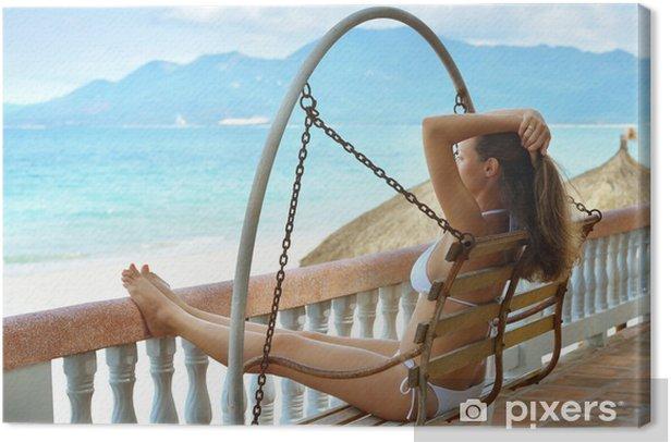 Leinwandbild Schöne Frau im Bikini auf der Terrasse der Träume - Urlaub