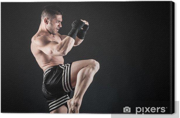 Leinwandbild Sportler Kick Boxer kämpfen gegen schwarzen Hintergrund. - Themen