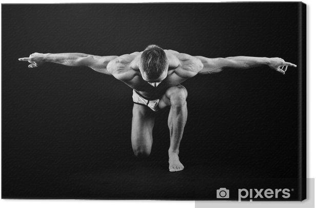 Leinwandbild Sportlicher Mann posiert -
