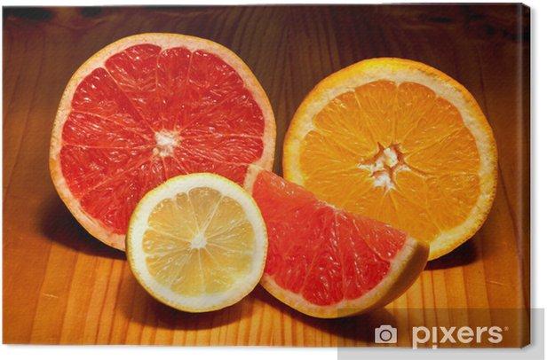 Leinwandbild Stücke von Zitrone, rote Grapefruit und Orange - Früchte