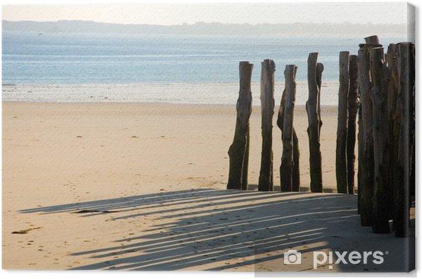 Leinwandbild Traditionelle Holzpflöcke in Saint-Malo (Bretagne, Frankreich) - Wasser