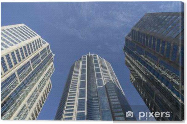 Lerretsbilde Abstrakt byggeperspektiv på blå himmel med skyer - kan brukes til visning eller montasje på produkt - Lanskap