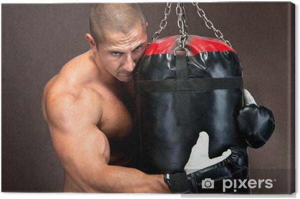 b374962e Lerretsbilde Atletisk ung mann trener kickboxing ved hjelp av svart  boksesekk