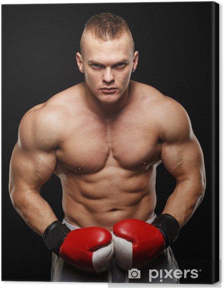 a9febdd3 Lerretsbilde Kjekk muskuløs ung mann som bærer boksehansker • Pixers ...