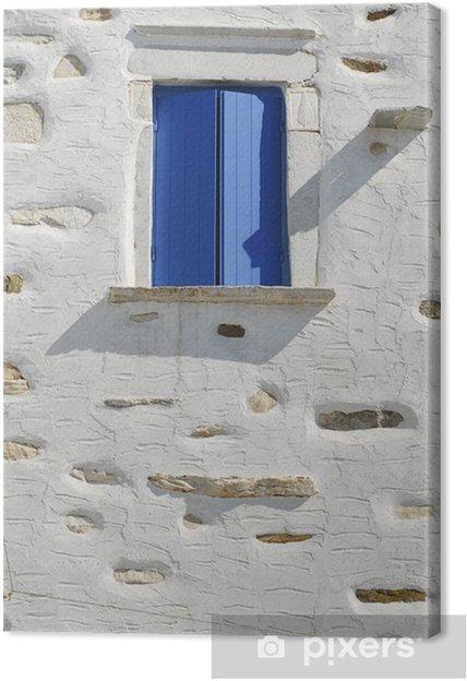 Obraz na plátně Modré okno ve starém domě v řeckém ostrově, řecko - Evropa