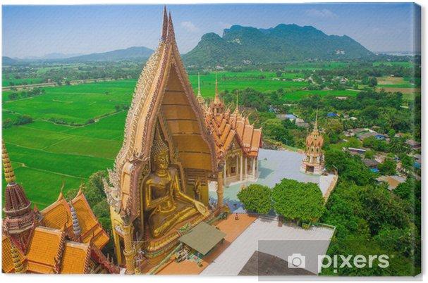 Obraz na plátně Velký zlatý Buddha v chrámu, Kanchanaburi Thailand - Památky