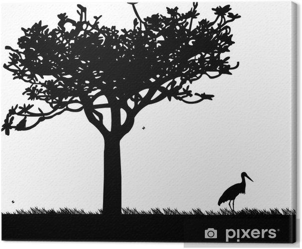 Obraz na płótnie Bocian w ogrodzie lub parku pod drzewem w sylwetce wiosennej - Pory roku