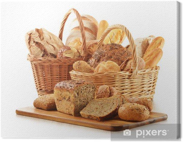 Obraz na płótnie Chleb i bułki w wiklinowych koszach na białym - Ryż