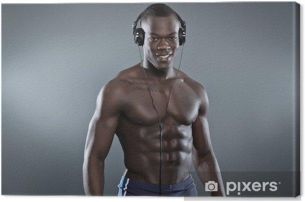 Obraz na płótnie Czarnym Afroamerykanin umięśnione siłownia człowiek ze słuchawkami Lista - Uroda i pielęgnacja ciała