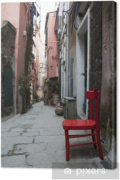 Obraz na płótnie Czerwone krzesło w włoskim alei - Europa