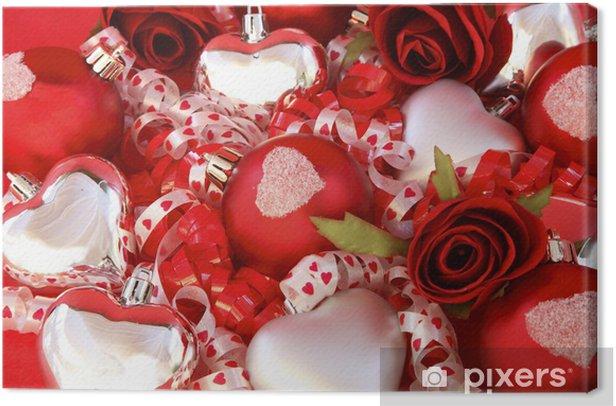 Obraz na płótnie Czerwone kulki satynowe, srebrne serca z róż i wstążka. - Pary