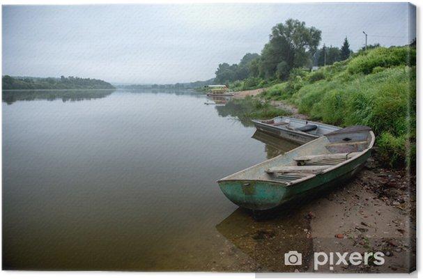 Obraz na płótnie Drewniane łodzie na wschód słońca w rosyjskim mieście Tarusa. -