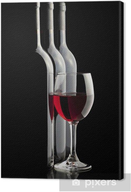 Obraz na płótnie Elegancki czerwonego szkła wina i butelki wina w czarnym tle - Tematy