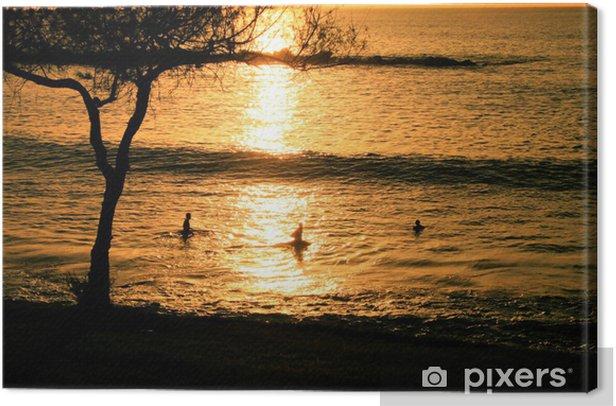 Obraz na płótnie Fale o zachodzie słońca - Wyspy
