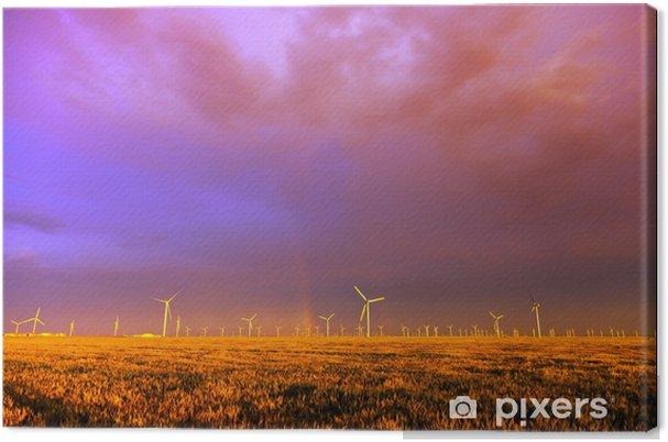 Obraz na płótnie Farma wiatrowa o zachodzie słońca po burzy - Niebo