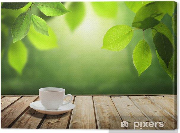 Obraz na płótnie Filiżanka kawy i słoneczny drzew w tle - Pory roku