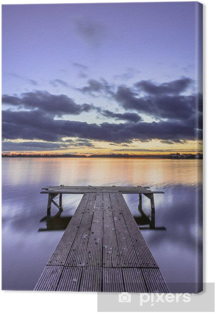 Obraz na płótnie Fioletowy Kolorowe zachód słońca nad spokojne jezioro z drewnianym molo - Woda