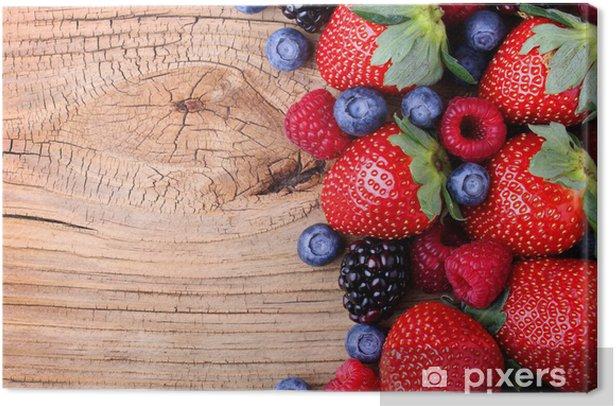 Obraz na płótnie Jagody na drewnianym tle - Tematy